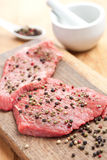 Raw beef steak with pepper Stock Image