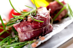 Raw beef steak with peppercorns Royalty Free Stock Photography