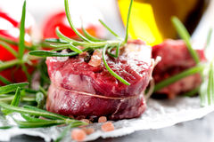 Raw beef steak with peppercorns and herbs Royalty Free Stock Image
