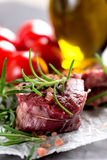 Raw beef steak with peppercorns and herbs Stock Image