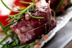 Raw beef steak with peppercorns Stock Photos