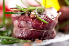 Raw beef steak with peppercorns and herbs Royalty Free Stock Photography