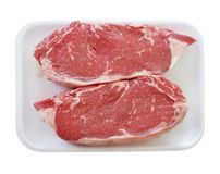 Raw beef steak in a plastic or foam  tray Stock Photo