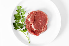 Raw beef steak on plate. Viewed from above Royalty Free Stock Photography