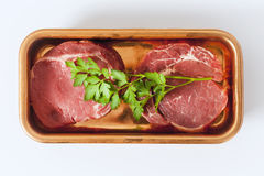 Raw beef steak on plate. Viewed from above Stock Photography