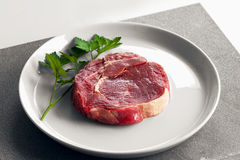 Raw beef steak on plate. Viewed from above Stock Photos