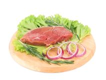 Raw beef steak on platter. Royalty Free Stock Photography