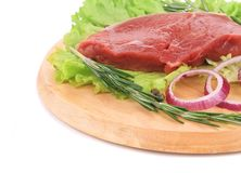 Raw beef steak on platter. Royalty Free Stock Images