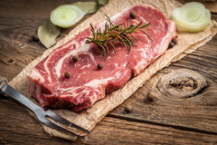 Raw beef steak. Raw beef steak ready to grill. Selective focus Royalty Free Stock Photos