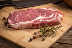 Raw beef steak. Raw beef steak ready to grill. Selective focus Stock Image