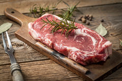 Raw beef steak. Raw beef steak ready to grill. Selective focus Royalty Free Stock Image