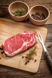 Raw beef steak. Raw beef steak ready to grill. Selective focus Royalty Free Stock Photography