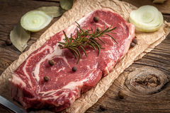 Raw beef steak. Raw beef steak ready to grill. Selective focus Royalty Free Stock Images