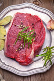 Raw beef steak. Raw beef steak ready to grill. Selective focus Stock Photography