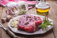 Raw beef steak. Raw beef steak ready to grill. Selective focus Stock Photos