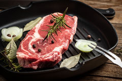 Raw beef steak. Raw beef steak ready to grill. Selective focus Royalty Free Stock Photo