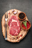 Raw beef steak Ribeye. Spices and herbs. Top view Royalty Free Stock Image
