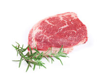 Raw beef steak and rosemary. Isolated on white background Stock Photography