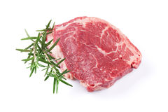 Raw beef steak. And rosemary. Isolated on white background Royalty Free Stock Photo