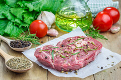 Raw beef steak with seasoning Royalty Free Stock Images