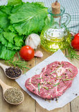 Raw beef steak with seasoning Royalty Free Stock Photos