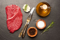 Raw beef steak and spices Royalty Free Stock Images