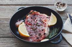 Raw beef steak with spices and herbs. Stock Photo