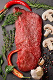 Raw beef steak with spices and herbs Stock Image