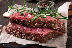 Raw beef steak with spices Royalty Free Stock Image