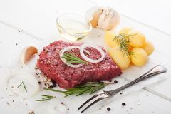 Raw beef steak and spices Stock Photos
