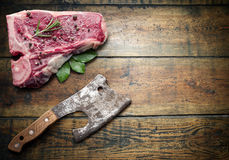 Raw beef steak with spices on a wooden board. Stock Photography