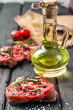 Raw beef steak and spices. On a wooden table Stock Image