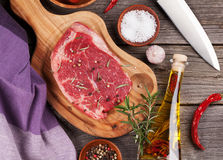 Raw beef steak and spices. On wooden table. Top view Stock Images