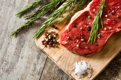 Raw beef steak with spicy ready to be cooked on wood. Raw beef steak with spicy ready to be cooked on wooden table. Copyspace Stock Photos