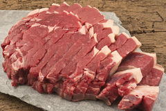 Raw beef steak. On stone on a wooden table Royalty Free Stock Photo