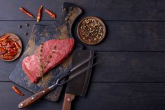 Raw beef steak with thyme and pepper Stock Photos