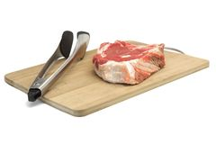 Raw Beef Steak,  Tongs On The Wood Cutting Board Isolated. Raw Beef Rib Eye Steak And  Tongs On The Bamboo Wood Cutting Board Isolated On White Background, Close Stock Images