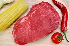 Raw Beef Steak And Vegetables Close-Up. Raw Beef Steak And Vegetables On Wood Background Close-Up Stock Photography