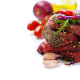 Raw beef steak. And vegetables over white Stock Image