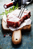 Raw beef steak and wine Stock Images