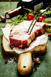 Raw beef steak and wine Royalty Free Stock Images