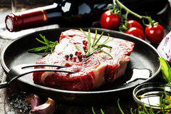 Raw beef steak and wine Stock Photography