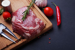 Raw beef steak on the wooden board Stock Photos