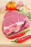 Raw beef steak. On wooden table Royalty Free Stock Photography
