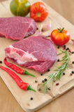 Raw beef steak. On wooden table Stock Photos