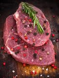 Raw beef steak on wooden table Stock Photography