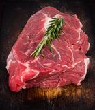 Raw beef steak on wooden table Stock Photos