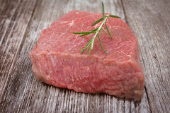 Raw beef steak on wooden table Royalty Free Stock Photography