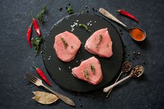 Raw beef steakes and peppers Royalty Free Stock Image