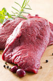 Raw Beef Steaks. As closeup on a wooden cutting board Stock Images